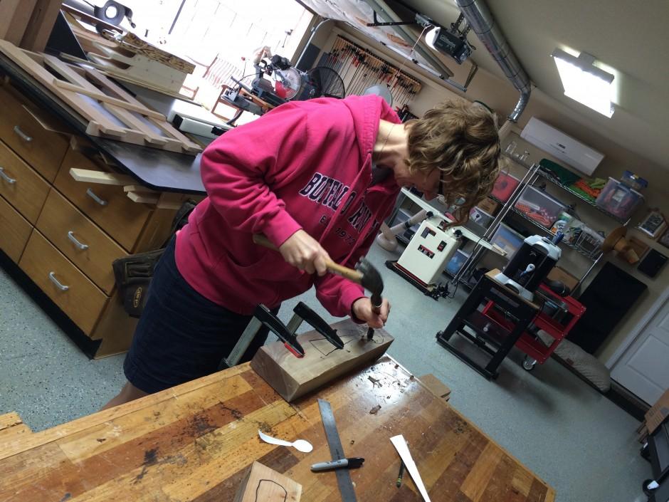 Nichole using hand tools.