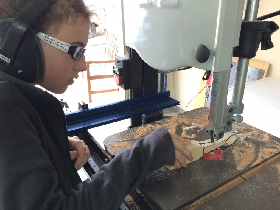 Mia using the bandsaw